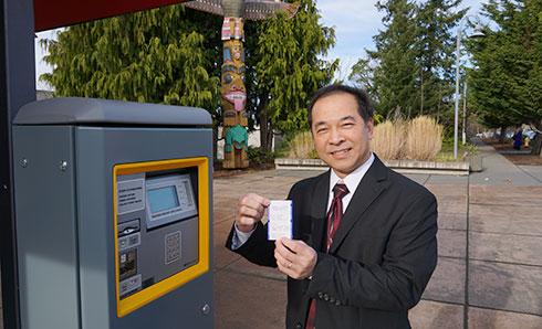 Michael Pham uses new Highline Parking Pay Station
