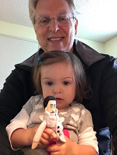Dr. Frank Kline with granddaughter