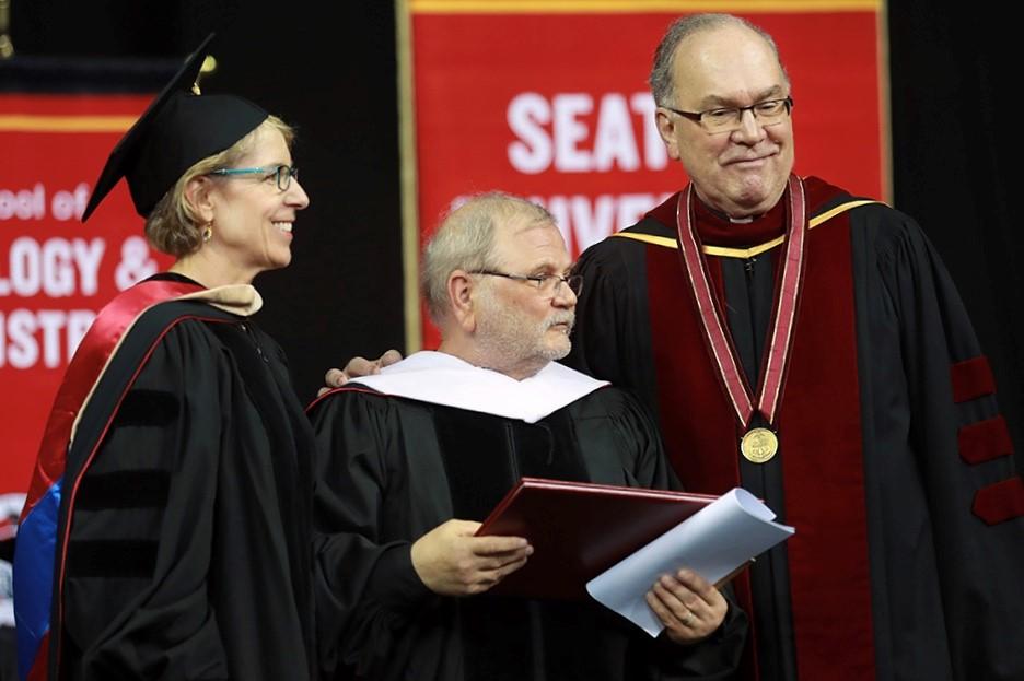 Photo of Highline College Alumnus Sam Green with Seattle University Administrators at 2018 Graduate Commencement; photo by Yosef Chaim Kalinko, Seattle University